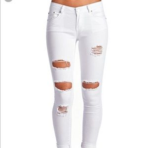 Mid rise distressed white jeans